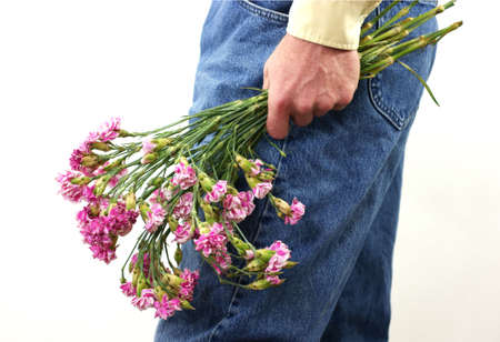 Old carnations in mans hand  photo