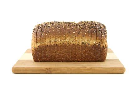 Healthy whole grain bread loaf on cutting board