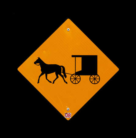 amish buggy: Horse and buggy sign with black background