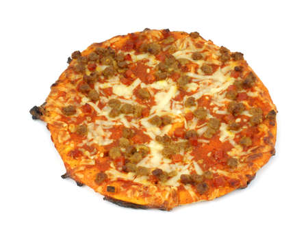 A small cooked inexpensive pizza with hamburger, sausage and cut pepperoni with cheese and sauce against a white background.  photo