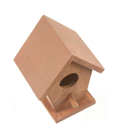 angled view: An angled view of a small birdhouse against a white background.