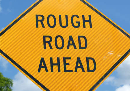 rough road: A warning sign signifying a rough road ahead.