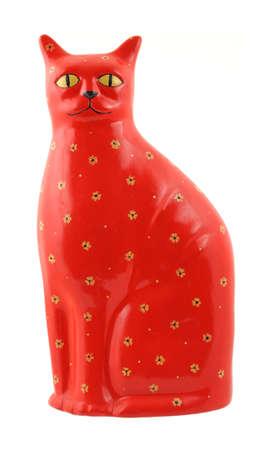 A very brightly colored red ceramic cat with yellow eyes and flowers. photo