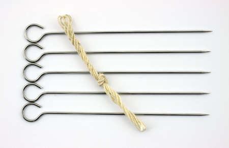 round rods: Five stainless steel turkey lacers with butchers twine