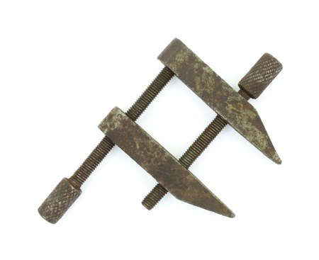 old items: A very old clamp used to hold small items.
