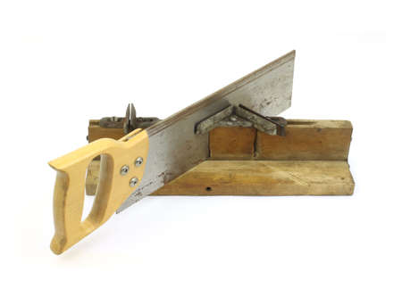 miter: Vintage miter box with saw Stock Photo