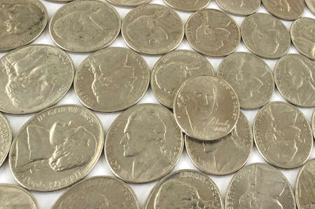 circulated: Several rows of nickels at an angle.  Stock Photo