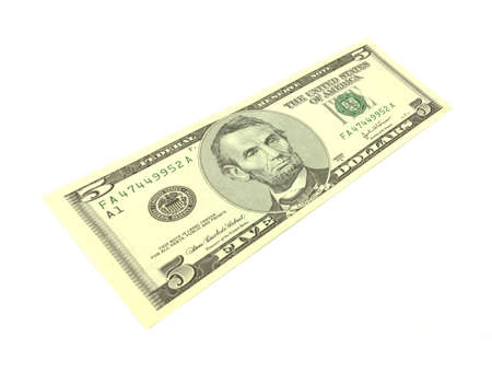 A single five dollar note at an angle stretched against a white background.  photo