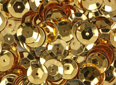 sequins: A close view of new gold sequins used for arts and crafts.  Stock Photo