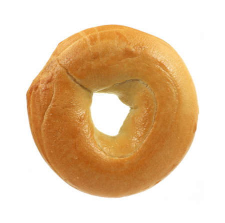 A single freshly baked plain bagel against a white background.  photo