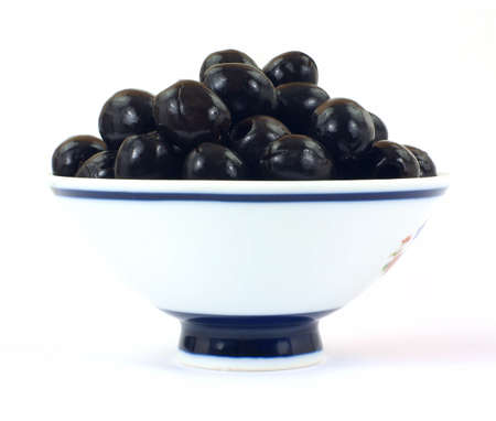 pitted: Black olives in bowl Stock Photo