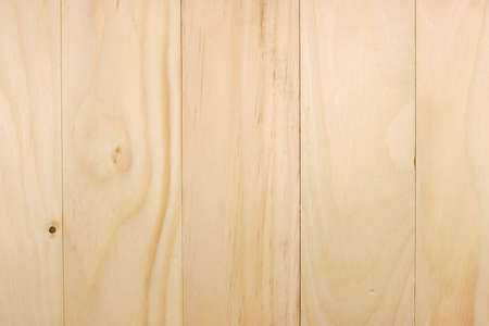 Several pine boards butted against each other for flooring and other construction projects.