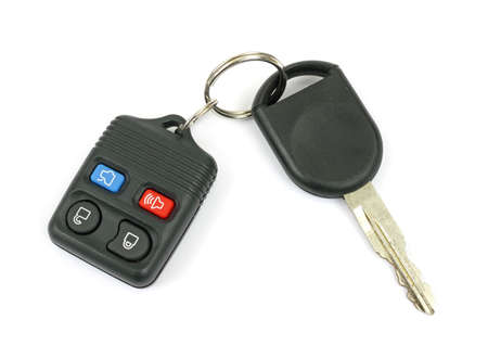 A set of new car keys against a white background.  Banco de Imagens