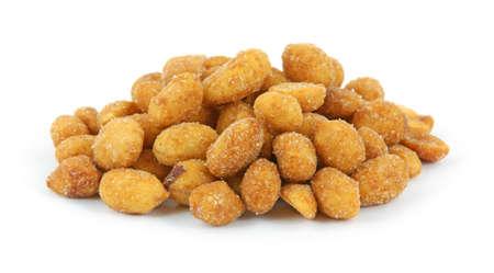 asados: La miel de cacahuetes tostados contra un fondo blanco.