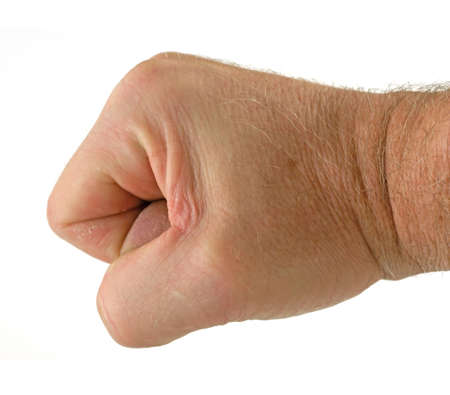 Side view of a mans fist against a white background. photo