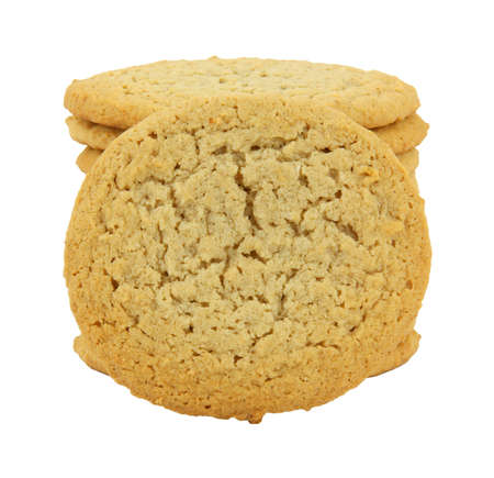 A stack of peanut butter cookies with a single cookie in front against a white background.