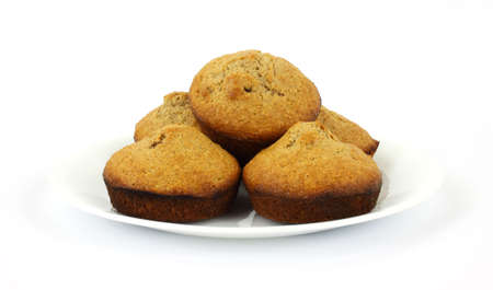 Fresh baked bran muffins on white plate photo