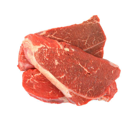 Three shoulder cut beef steaks against a white background.  photo