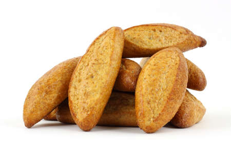 A group of several freshly baked wheat sub rolls against a white background. Stok Fotoğraf