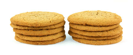 Two small stacks of peanut butter cookies