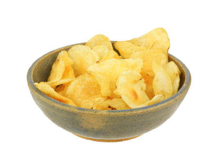 Plain potato chips in an old bowl Stock Photo