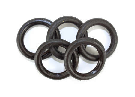 rubber gasket: A group of five O ring washers for lawn and garden products on a white background.