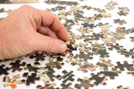 Vintage puzzle pieces with mans hand photo