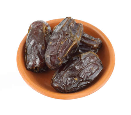 Medjool dates in a terra cotta dish