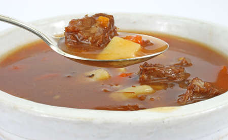 A close view of a spoonful of beef pot roast stew. photo