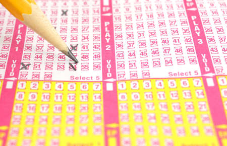 filled out: Close view of  a generic lottery ticket form being filled out. Stock Photo
