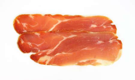 Two slices of prosciutto ham on a white background. Stok Fotoğraf