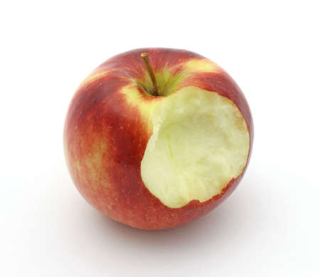 bitten: A single empire apple which has been bitten on a white background.