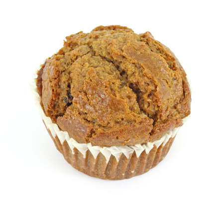 A freshly baked raisin bran muffin on a white background. Stok Fotoğraf - 7065953