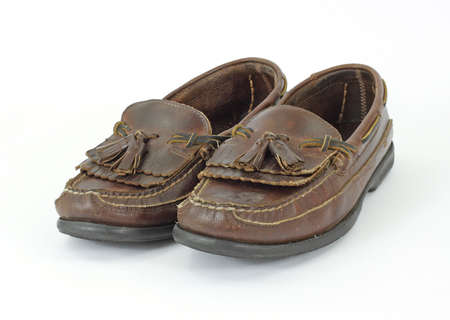 loafers: An old pair of mans loafers with tassels on a white background. Stock Photo