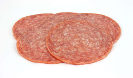 Sliced genoa salami on a white background.