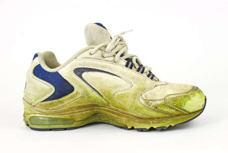 Single grass stained old sneaker photo