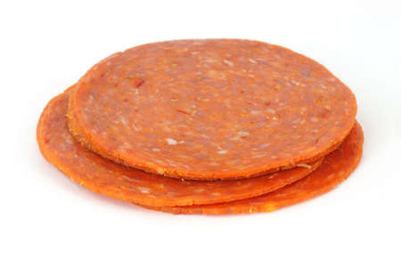 Small stack of deli cut pepperoni on a white background.