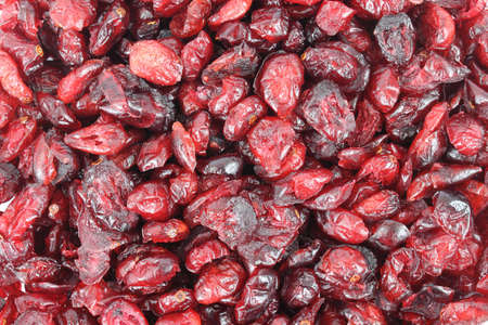 sweetened: A close view of a layer of sweetened dried cranberries. Stock Photo