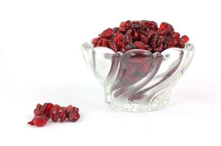 sweetened: A bowl of sweetened dried cranberries with several loose berries in the foreground. Stock Photo