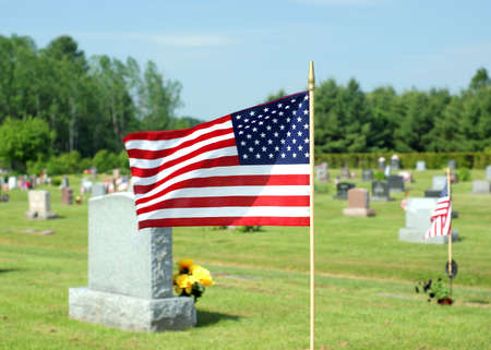 A small American flag waving in the wind for Memorial Day. photo