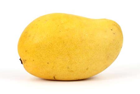 A fresh yellow mango on a white background.