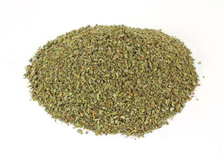A small mound of dried cut and chopped marjoram herb.