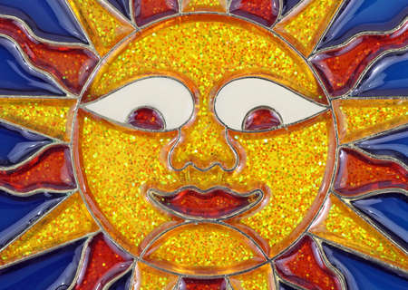 Close view of a leaded glass colorful sun face. Stock Photo - 7216447