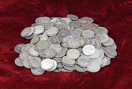 Old silver dimes on a red velvet cloth background. Stock Photo - 7261055