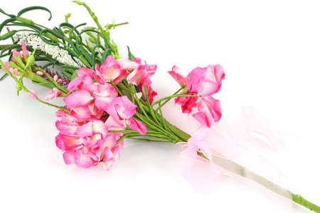 A small bouquet of pink paper flowers with a bow on a white a small bouquet of pink paper flowers with a bow on a white background stock mightylinksfo