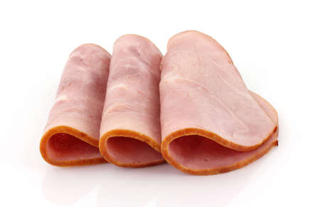 Three slices of baked ham that have been folded in half on a white background.