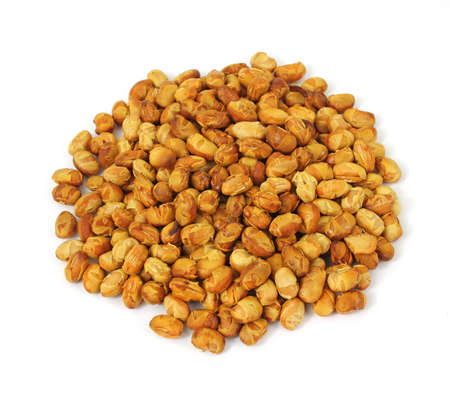 A portion of roasted soy nuts on a white background.