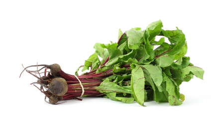 Fresh leafy beet greens with beets on a white background.