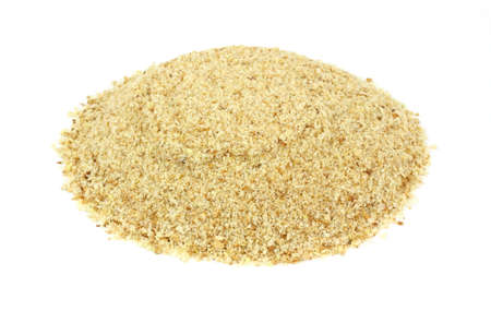 seasoned: A large amount of seasoned bread crumbs on a white background.