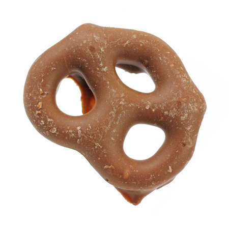 pretzel: A single milk chocolate covered pretzel on a white background.